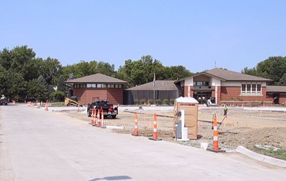 An image of the Waukee Public Library and its newly paved driveway and parking lot