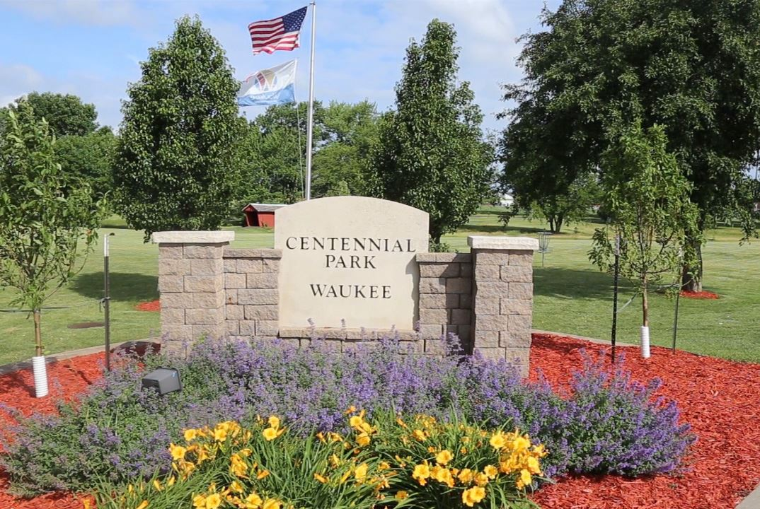 centennial park sign and flowers june 2018